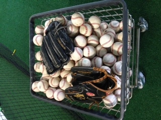 professional major league baseballs and gloves close up  at a secret sports training camp facility